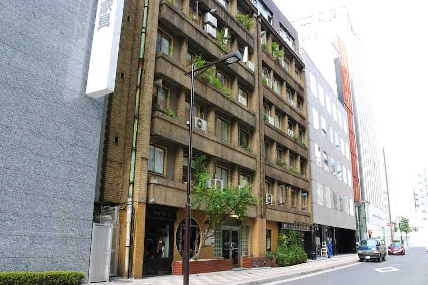 The historical 1930s architecture of the Okuno Building in Ginza betwee